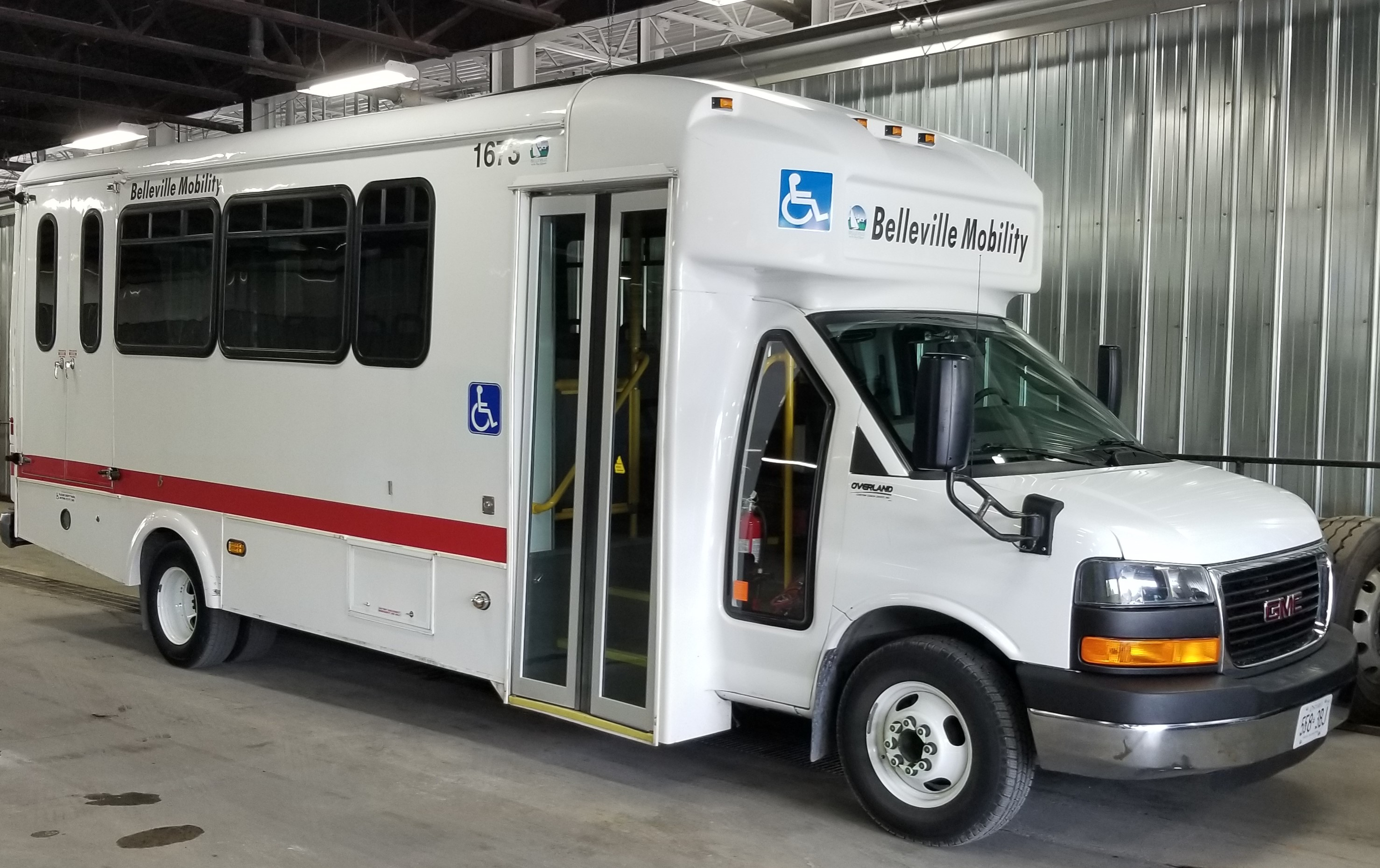 the Mobility Bus vehicle is shorter than a conventional transit bus and features rear lift boarding for people using mobility devices