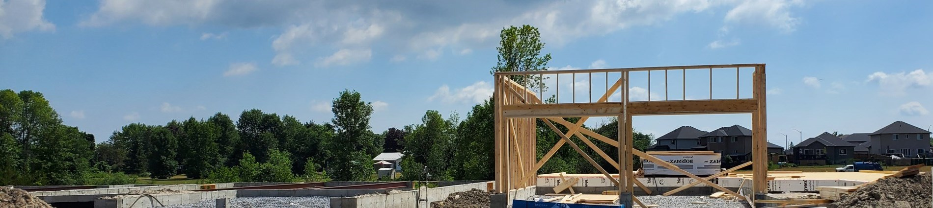 Landscape photo of subdivision and house frame