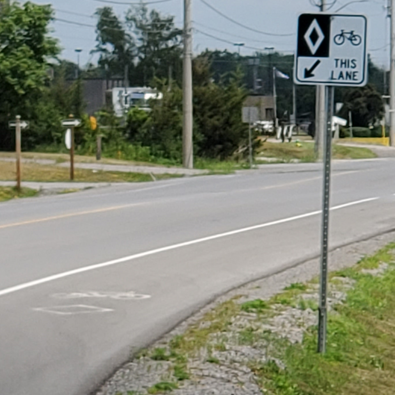 Photo of a bike lane and road sign